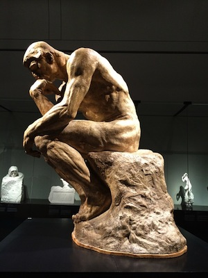 "Think your way to better grades - photo of ""The Thinker"" scupture"