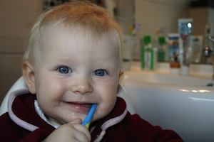 What makes you stronger when you break it? Photo baby with toothbrush