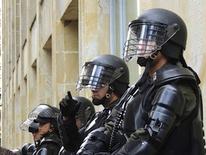 Learning is fun! Or is it? Photo of riot police
