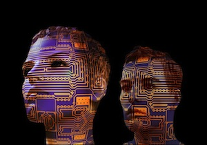 Intelligence is a movable feast! - Image of two heads with circuit boards