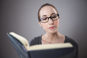 Laser-sharp mental focus - photo of woman reading a book