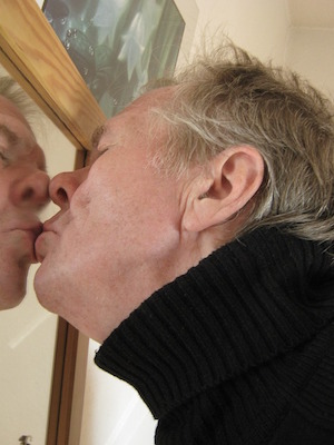 Inny or outy? Which way's your attention facing? - photo of man kissing his reflection