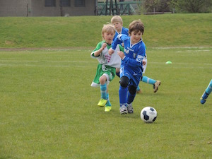 Play word association football when revising for exams - phot of children playing football