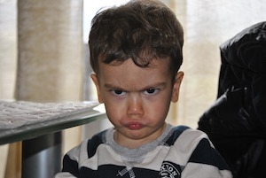 Who likes a good moan? Photo of child pouting.