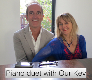 What does watching a reality show say about you? Photo of Kevin McCloud and Lysette Offley laying a piano duet