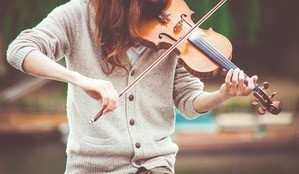 What would you give to achieve your goals? - woman playing violin